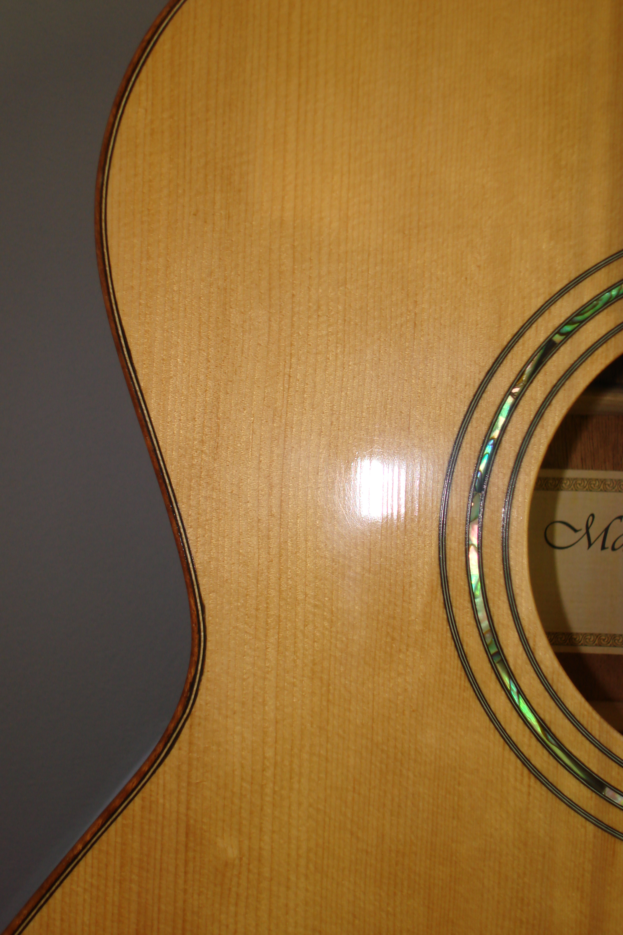 Grand Auditorium:  Binding and Sound Hole Detail